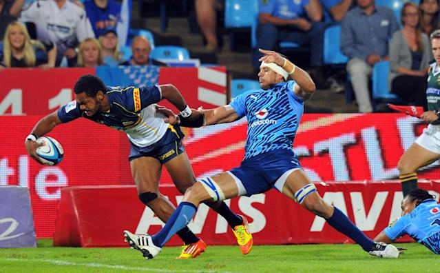 Australian ACT Brumbies' winger Henry Speight (L) scores a try during the Super 15 Rugby Match between Northern Bulls and Canterbury Crusaders at Loftus Versfeld stadium in Pretoria, on April 21, 2012. AFP PHOTO/ ALEXANDER JOE (Photo credit should read ALEXANDER JOE/AFP/Getty Images)