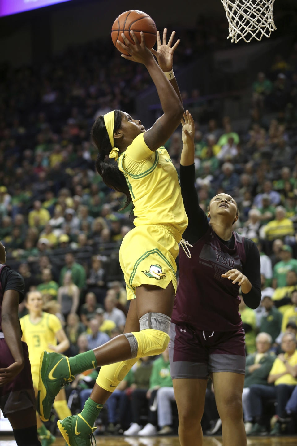 Oregon's Ruthy Hebard, left, shots over Texas Southern's Lauren Lewis during second quarter of an NCAA college basketball game in Eugene, Ore., Saturday, Nov. 16, 2019. (AP Photo/Chris Pietsch)