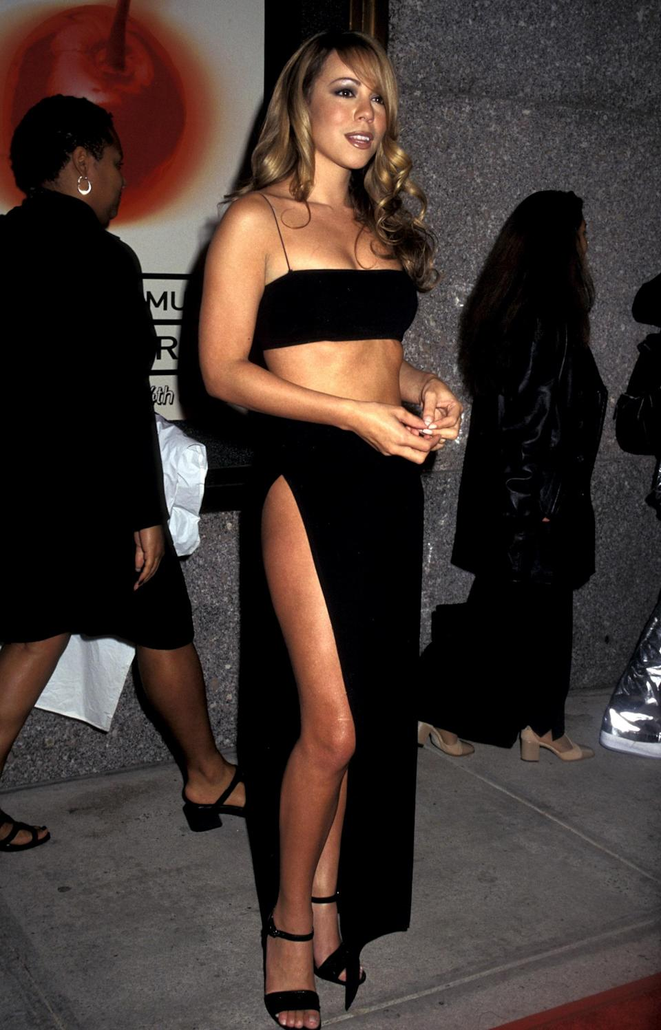 Those bandeaus and thigh-high slits that Bella and Kendall execute so flawlessly? Mariah was doing them first.