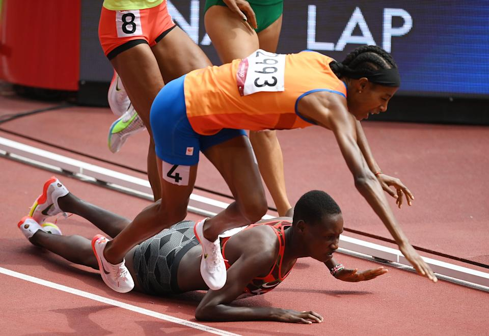 The Netherlands' Sifan Hassan (4) and Kenya's Edinah Jebitok trip and fall during their 1,500-meter heat at the Tokyo Olympics.