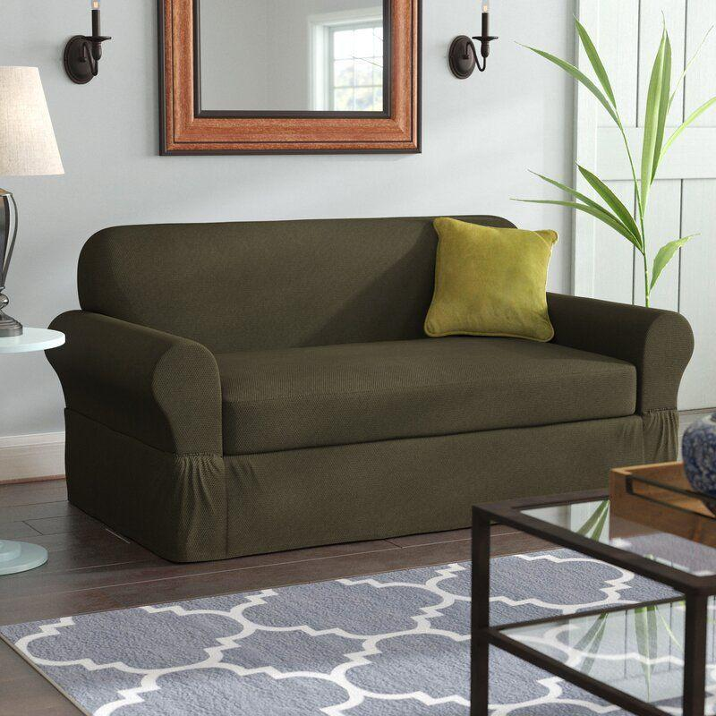 """<p><strong>Darby Home Co.</strong></p><p>wayfair.com</p><p><strong>$99.90</strong></p><p><a href=""""https://go.redirectingat.com?id=74968X1596630&url=https%3A%2F%2Fwww.wayfair.com%2Ffurniture%2Fpdp%2Fdarby-home-co-box-cushion-sofa-slipcover-w004846819.html&sref=https%3A%2F%2Fwww.bestproducts.com%2Fhome%2Fdecor%2Fg2733%2Fbest-sofa-couch-covers-and-slipcovers%2F"""" rel=""""nofollow noopener"""" target=""""_blank"""" data-ylk=""""slk:Shop Now"""" class=""""link rapid-noclick-resp"""">Shop Now</a></p><p>This pick is a streamlined take on the sofa cover — its elasticized, two-piece construction is ideal for those who don't want it to be at all noticeable. Users love the sophisticated gray color, and that it stays securely in place, even with children wiggling around on it. </p>"""