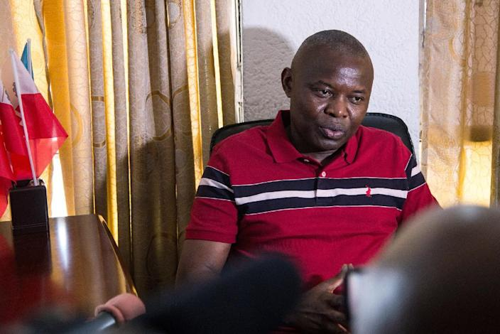 Vital Kamerhe, member of the UNC opposition party, speaks to journalists on September 13, 2014, at the party's headquarters in Barumbu, DR Congo (AFP Photo/Junior D. Kannah)