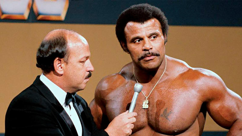 """Mean"" Gene Okerlund (pictured left) interviews Rocky ""Soul Man"" Johnson (pictured right). (AAP)"