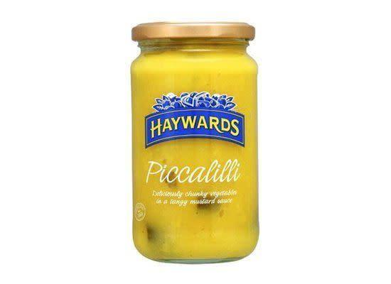 """<em>pi-ka-lih-lee</em> A relish made from cauliflower, root vegetables, vinegar, salt, sugar, mustard and turmeric, among other spices. <strong>How to Use:</strong> Use as a condiment or topping. <strong>Origin:</strong> Great Britain. <strong><a href=""""http://www.amazon.com/Haywards-Piccalilli-460gr-16-2ozs-Each/dp/B001NJMFP0"""" rel=""""nofollow noopener"""" target=""""_blank"""" data-ylk=""""slk:Piccalilli"""" class=""""link rapid-noclick-resp"""">Piccalilli</a> at Amazon.com, $7.25</strong>"""