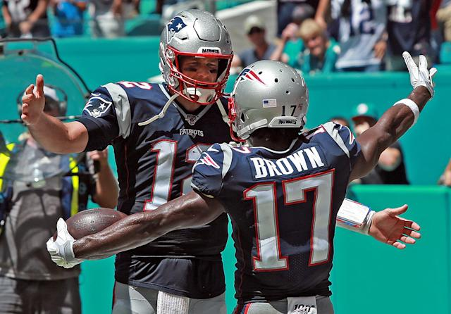 """Tom Brady celebrates Antonio Brown's touchdown for the New England Patriots against the <a class=""""link rapid-noclick-resp"""" href=""""/nfl/teams/miami/"""" data-ylk=""""slk:Miami Dolphins"""">Miami Dolphins</a> on Sept. 15, 2019. (Staff Photo By Matt Stone/MediaNews Group/Boston Herald)"""