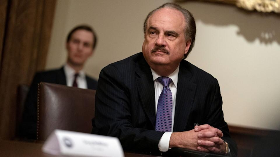 Mandatory Credit: Photo by Evan Vucci/AP/Shutterstock (10660159a)Larry Merlo listens during a meeting with President Donald Trump about coronavirus testing, in the Cabinet Room of the White House in Washington.