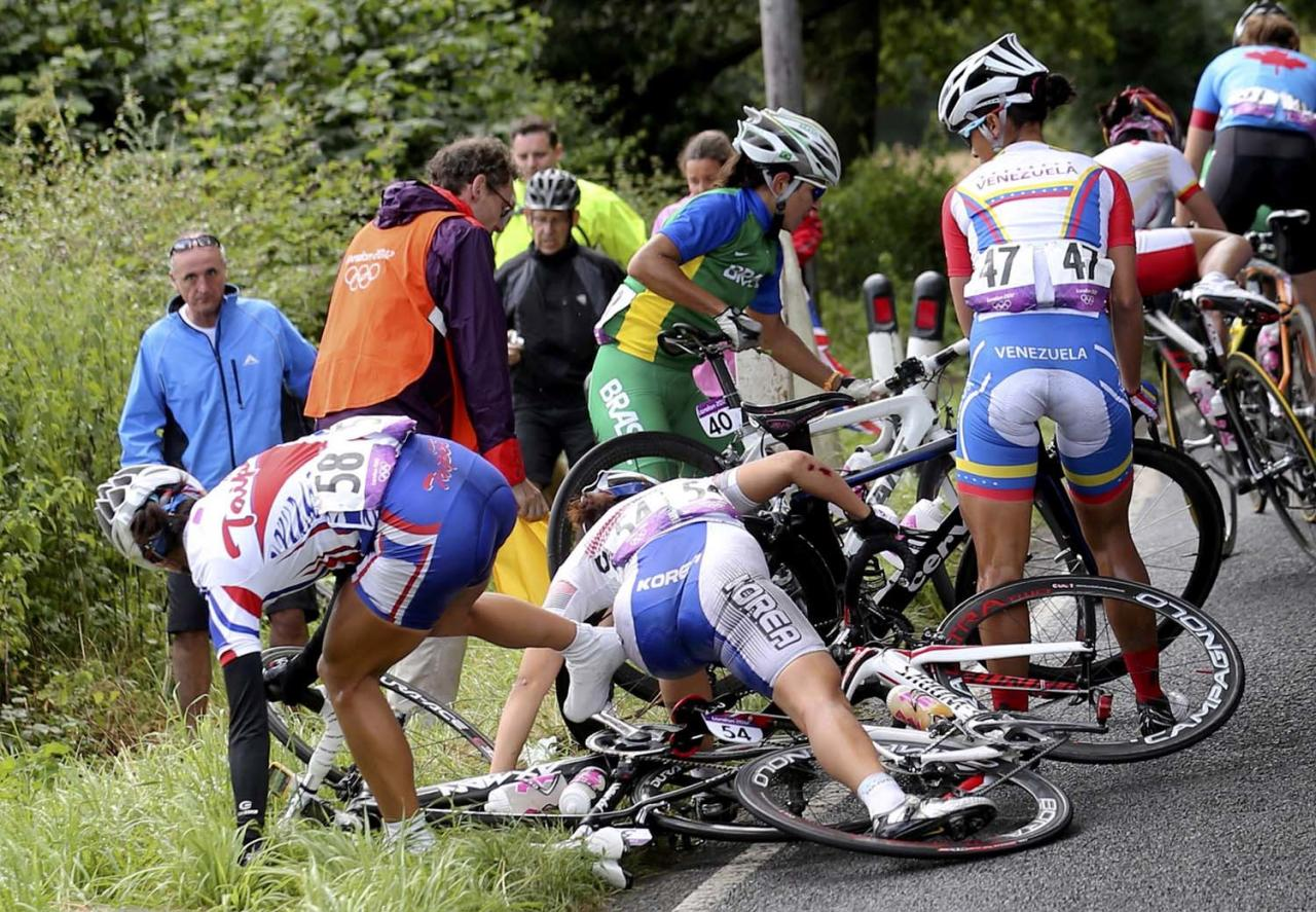 LONDON, ENGLAND - JULY 29:  Taiwan's Hsiao Mei Yu (58), South Korea's Na Ah-reum (54), Brazil's Fernanda da Silva Souza (40) and Venezuela's Danielys Garcia (47) try to recover from a crash during the Women's Road Race Road Cycling Day 2 of the London 2012 Olympic Games on July 29, 2012 in London, England. (Photo by Stefano Rellandini - IOPP Pool Getty Images)