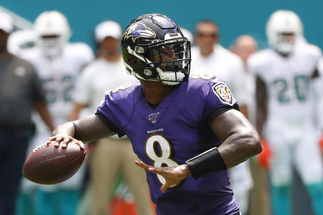 FILE - In this Sunday, Sept. 8, 2019, file photo, Baltimore Ravens quarterback Lamar Jackson (8) looks to pass during the first half at an NFL football game against the Miami Dolphins in Miami Gardens, Fla. Boosting the Ravens to the top in yards gained is an average of 541.5 yards, led by Jacksons superb passing and running. (AP Photo/Wilfredo Lee, File)