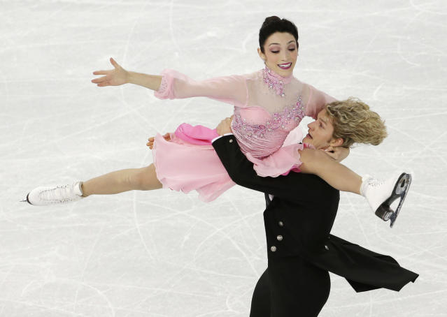 Meryl Davis and Charlie White of the United States compete in the team ice dance short dance figure skating competition at the Iceberg Skating Palace during the 2014 Winter Olympics, Saturday, Feb. 8, 2014, in Sochi, Russia. (AP Photo/Bernat Armangue)