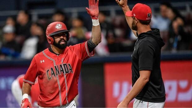 Major League Baseball and players' association agreed in February players not on 26-man rosters would be available for the men's Olympic qualifier in June. Former Blue Jays outfielder Dalton Pompey, left, played in the Premier 12 qualifying tourney in November 2019. (Jung Yeon-Je/AFP via Getty Images/File - image credit)
