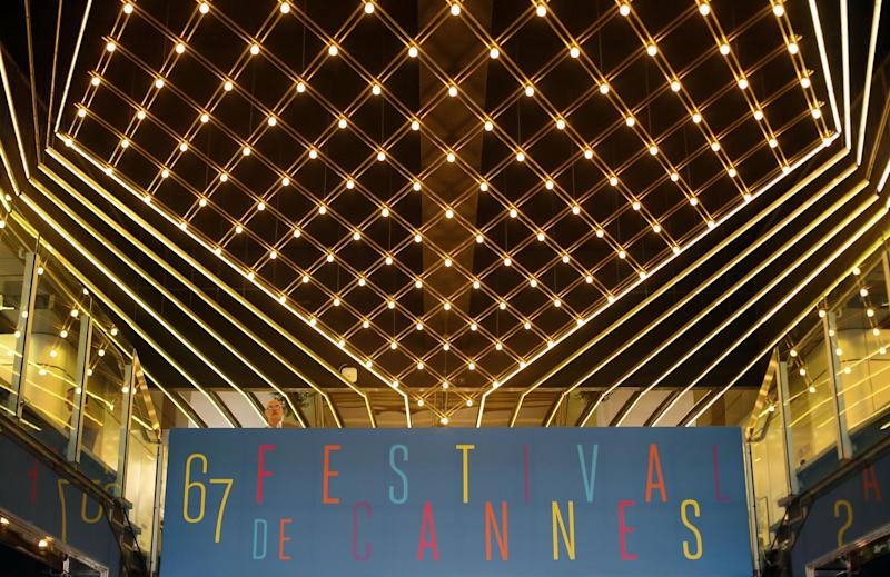 A man stands on the second floor balcony in the interior of the Palais des Festivals during final preparations for the 67th international film festival in Cannes, southern France, Tuesday, May 13, 2014. The festival runs from May 14th to May 25th. (AP Photo/Alastair Grant)