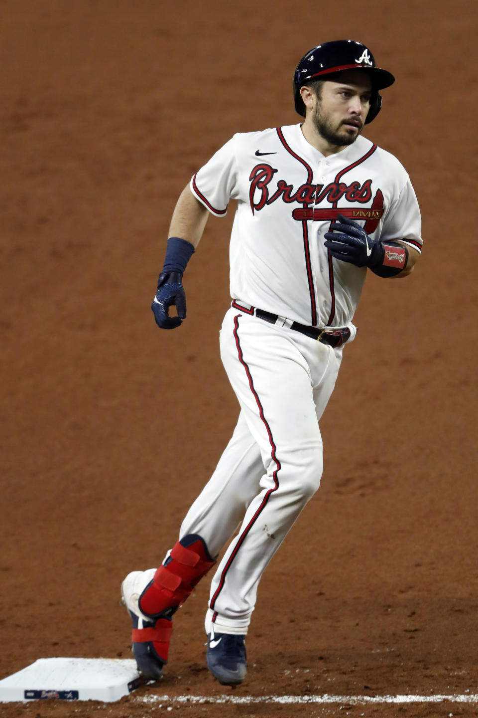Atlanta Braves' Travis d'Arnaud rounds third base after hitting a home run in the fifth inning of a baseball game against the New York Mets Monday, Aug. 3, 2020, in Atlanta. (AP Photo/John Bazemore)