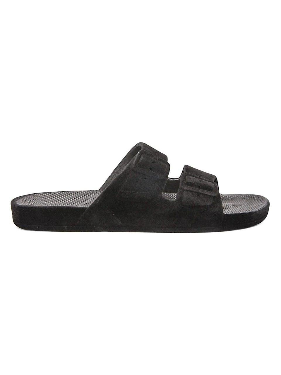 """<br><br><strong>Freedom Moses</strong> Bond Velvet Two-Strap Slides, $, available at <a href=""""https://www.saksfifthavenue.com/product/freedom-moses-bond-velvet-two-strap-slides-0400013270940.html?ranMID=37410&ranEAID=0RpXOIXA500&ranSiteID=0RpXOIXA500-Dpw1GFbiYMuOvFjheQt78Q&site_refer=AFF001&mid=37410&siteID=0RpXOIXA500-Dpw1GFbiYMuOvFjheQt78Q"""" rel=""""nofollow noopener"""" target=""""_blank"""" data-ylk=""""slk:Saks Fifth Avenue"""" class=""""link rapid-noclick-resp"""">Saks Fifth Avenue</a>"""