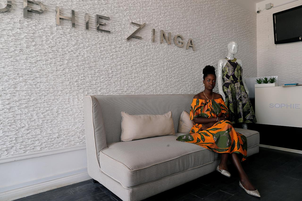 Sophie Zinga, a fashion designer is pictured at her shop in Dakar, Senegal February 13, 2019. Zinga is hoping the next president will do more to empower women, train youths and boost the creative industry to turn Dakar into the fashion hub of West Africa. Picture taken February 13, 2019 REUTERS/ Zohra Bensemra
