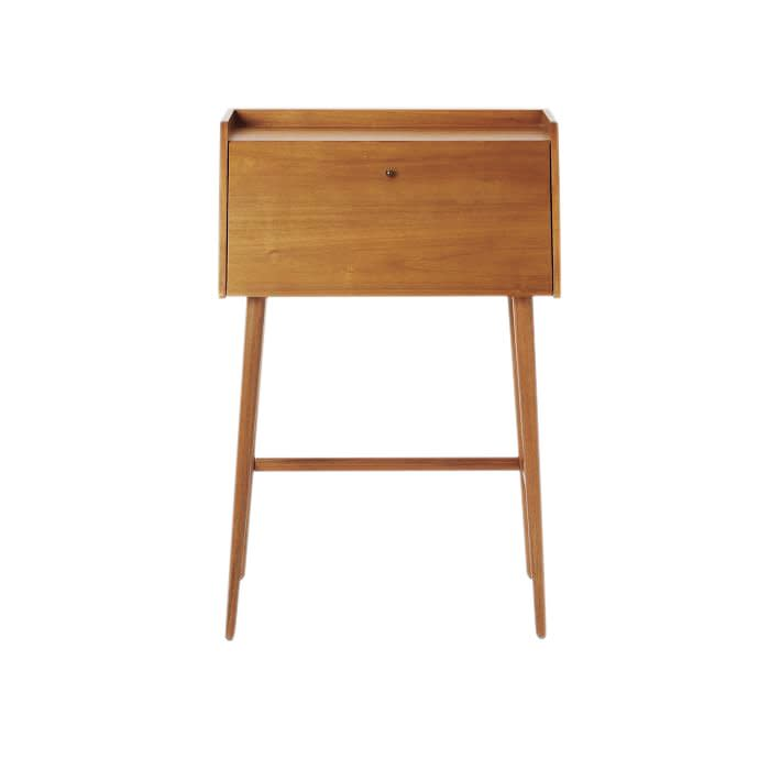 """<p>A nod to the traditional secretary desk, this smaller version is both charming and functional. With a flip down door that opens to storage space, you can easily hide your office supplies in a flash.</p> <p><strong>To buy: </strong>$399, <a href=""""http://westelm.7eer.net/c/249354/267856/4336?subId1=RS%2CThe7BestDesksforSmallSpaces%2Ckholdefehr1271%2CDEC%2CIMA%2C681176%2C201910%2CI&u=https%3A%2F%2Fwww.westelm.com%2Fproducts%2Fmid-century-mini-secretary-h2096%2F%3F"""" target=""""_blank"""">westelm.com</a>.</p>"""
