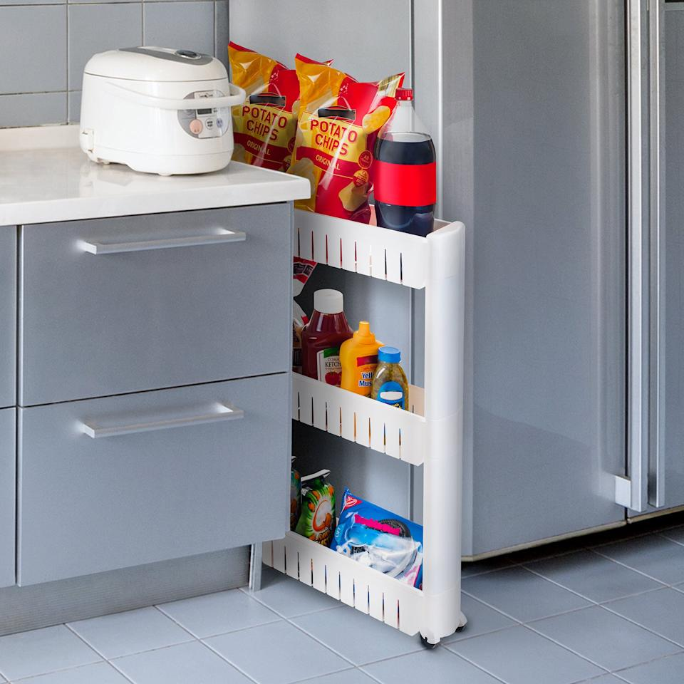 "<p>I have a weird awkward space between my fridge and my cabinets, and this <a href=""https://www.popsugar.com/buy/Everyday-Home-Portable-Shelving-Unit-Organizer-407459?p_name=Everyday%20Home%20Portable%20Shelving%20Unit%20Organizer&retailer=walmart.com&pid=407459&price=16&evar1=casa%3Aus&evar9=47092931&evar98=https%3A%2F%2Fwww.popsugar.com%2Fphoto-gallery%2F47092931%2Fimage%2F47092987%2FEveryday-Home-Portable-Shelving-Unit-Organizer&list1=shopping%2Ceditors%20pick%2Corganization%2Ckitchens%2Csmall%20space%20living%2Chome%20organization%2Chome%20shopping&prop13=api&pdata=1"" rel=""nofollow"" data-shoppable-link=""1"" target=""_blank"" class=""ga-track"" data-ga-category=""Related"" data-ga-label=""https://www.walmart.com/ip/Everyday-Home-Portable-Shelving-Unit-Organizer-with-3-Large-Storage-Baskets/824297026"" data-ga-action=""In-Line Links"">Everyday Home Portable Shelving Unit Organizer</a> ($16) is the perfect way to use it.</p>"