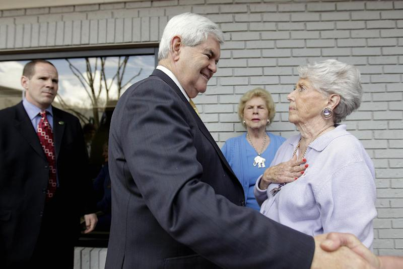Republican presidential candidate, former House Speaker Newt Gingrich greets Betty Weeks, right, and Helen Smally, rear, at a campaign event, Tuesday, March 13, 2012, in Vestavia Hills, Ala. (AP Photo/David Goldman)