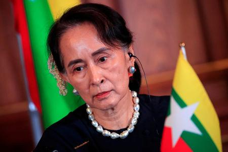 FILE PHOTO: Myanmar's State Counsellor Aung San Suu Kyi attends the joint news conference of the Japan-Mekong Summit Meeting at the Akasaka Palace State Guest House in Tokyo, Japan October 9, 2018. Franck Robichon/Pool via Reuters/File Photo