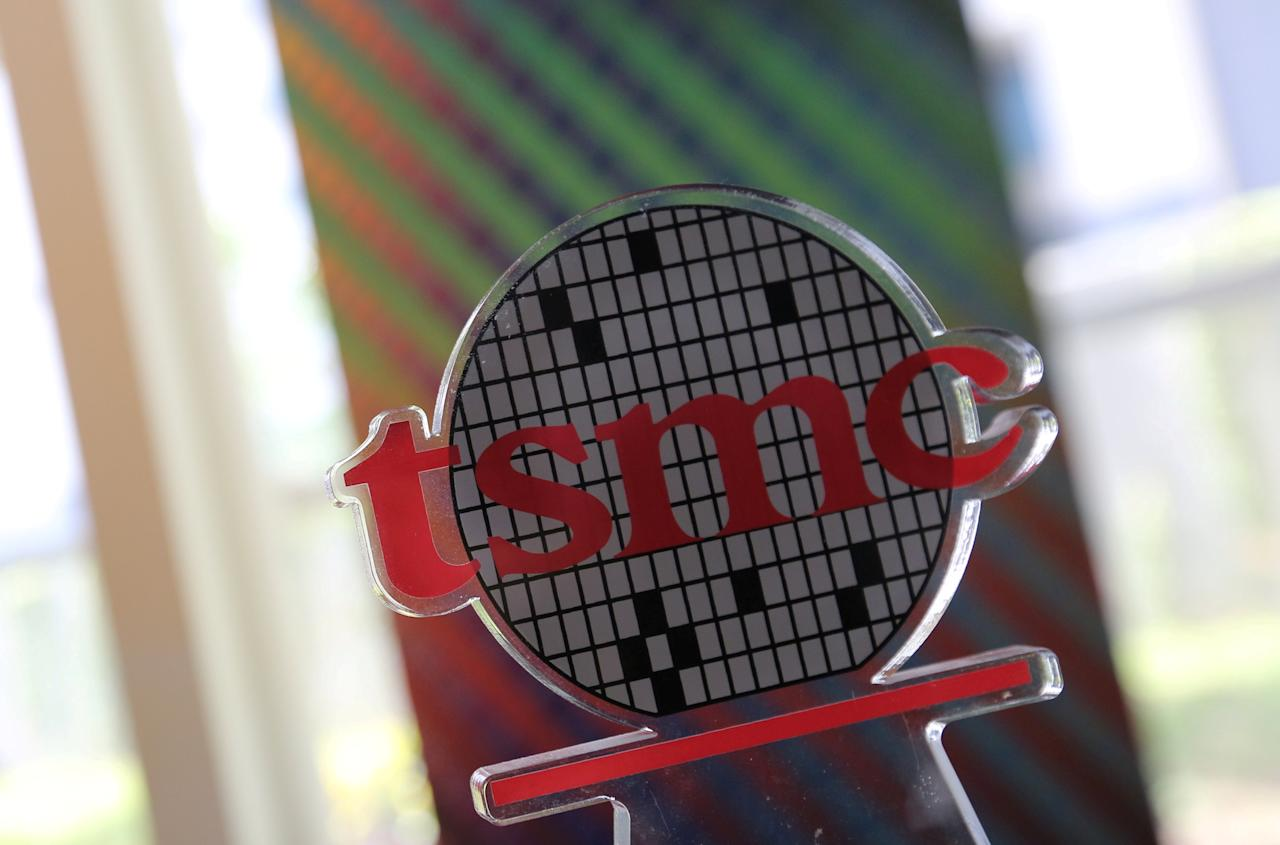 FILE PHOTO: A logo of Taiwan Semiconductor Manufacturing Co (TSMC) is seen at its headquarters in Hsinchu, Taiwan October 5, 2017.   REUTERS/Eason Lam/File Photo