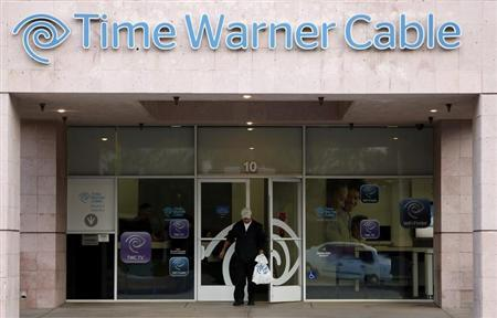 A customer leaves a Time Warner Cable store in Palm Springs