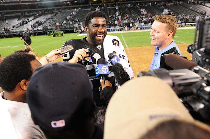 In this 2009 file photo, Oakland Raiders defensive end Greg Ellis talks to the media after a game against the Dallas Cowboys at Oakland-Alameda County Coliseum. The Raiders defeated the Cowboys 31-10.