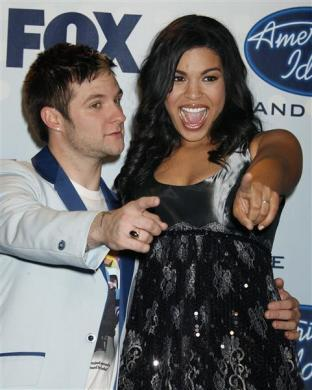 "17 year-old Jordin Sparks (R) smiles after winning at the finale of the television reality series ""American Idol"" as she poses with runner-up 25 year-old Blake Lewis in Hollywood, California May 23, 2007."