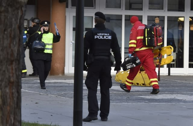 Police personnel and paramedics outside Ostrava Teaching Hospital after a shooting incident in the Czech Republic