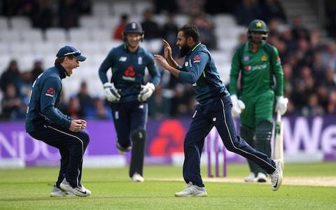 Adil Rashid of England celebrates with captain Eoin Morgan after dismissing Shoaib Malik - Credit: Getty Images