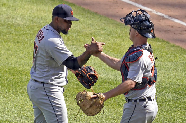 Detroit Tigers relief pitcher Jose Cisnero, left, celebrates with catcher Jake Rogers after the Tigers defeated the Chicago White Sox 4-3 in a baseball game in Chicago, Saturday, June 5, 2021. (AP Photo/Nam Y. Huh)