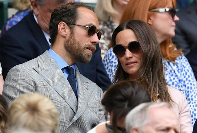 Kate, the Duchess of Cambridge's brother James Middleton and sister Pippa in the Royal Box (AFP Photo/Ben STANSALL)