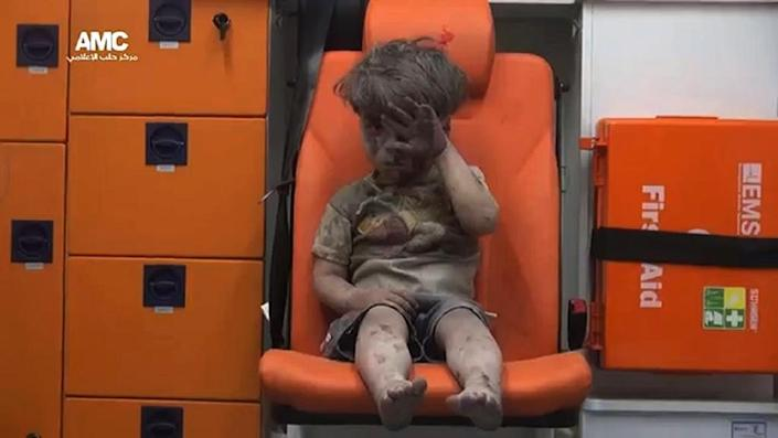 """Photographer Mahmoud Rslan, who captured the image of Omran, said the shell-shocked boy was """"speechless, staring blankly"""" (AFP Photo/)"""