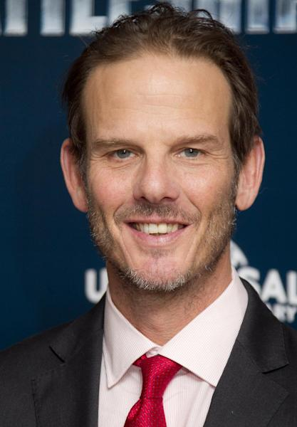 "FILE - In this March 28, 2012 file photo, director Peter Berg poses for photographs at a central London hotel for the photo call of ""Battleship."" Berg, who created TV's ""Friday Night Lights,"" is accusing Mitt Romney of plagiarizing a phrase from the show to use as a campaign slogan. (AP Photo/Joel Ryan, Fie)"