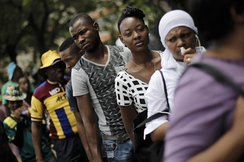 People wanting to pay their respects to Nelson Mandela queue in downtown Pretoria, South Africa, Friday, Dec. 13, 2013. Former South African President Nelson Mandela is on the third and final day of lying in state at the Union Buildings in Pretoria. (AP Photo/Markus Schreiber)