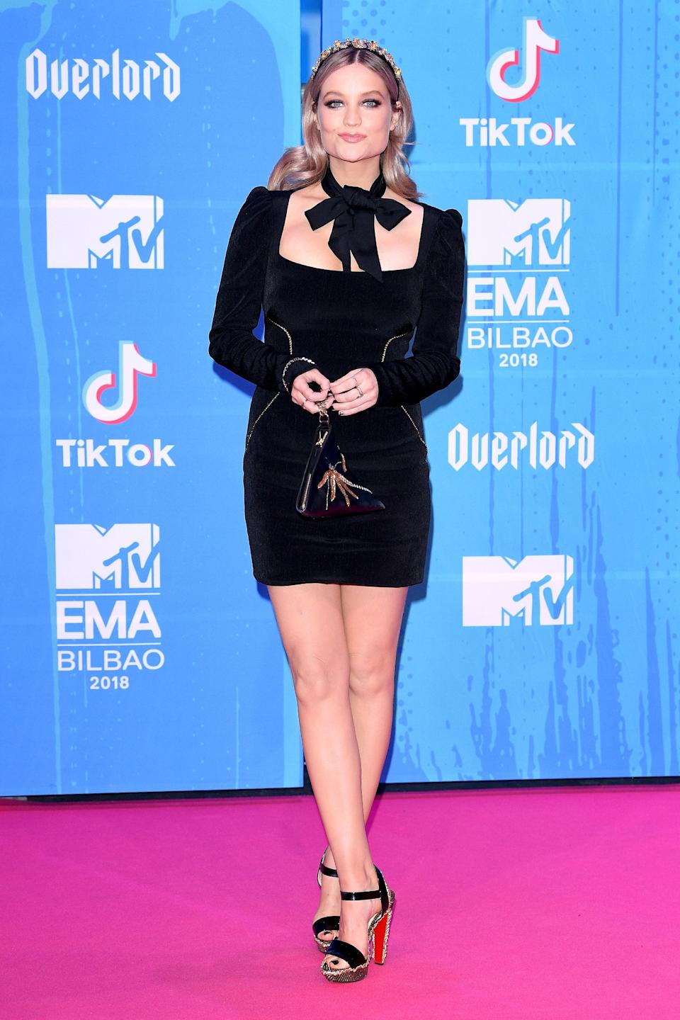 <p>The television presenter wore a Rebecca Vallance black mini dress with a pussy bow at the MTV EMAs 2018 in Bilbao, Spain. <em>[Photo: Getty]</em> </p>