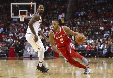 Nov 9, 2017; Houston, TX, USA; Houston Rockets guard Eric Gordon (10) attempts to dribble around Cleveland Cavaliers guard JR Smith (5) during the first quarter at Toyota Center. Mandatory Credit: Troy Taormina-USA TODAY Sports