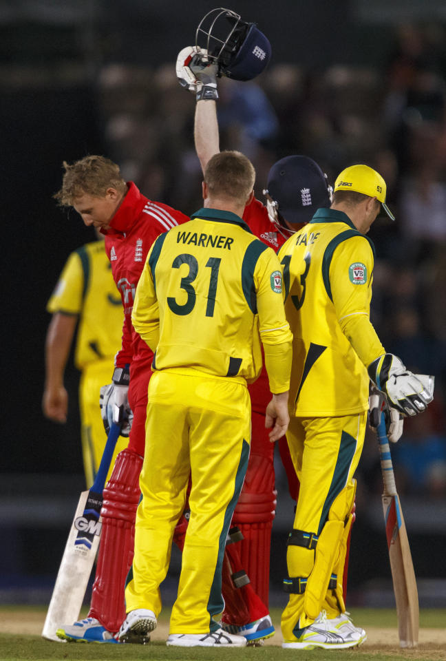 Australia's David Warner speaks to England's Joe Root after he was struck in the mouth by a ball from Mitchell Johnson breaking his helmet during the International Twenty20 match at the Ageas Bowl, Southampton.