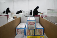 FILE - In this Sunday, Dec. 20, 2020 file photo, boxes containing the Moderna COVID-19 vaccine are prepared for shipment at the McKesson distribution center in Olive Branch, Miss. (AP Photo/Paul Sancya, Pool)