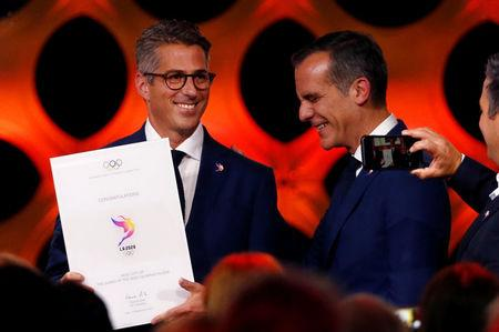 Chairman of Los Angeles 2028 Casey Wasserman and Mayor of Los Angeles Eric Garcetti react after ratifiying Paris 2024 and Los Angeles 2028 host cities for Olympics games during the 131st IOC session in Lima, Peru September 13, 2017. REUTERS/Mariana Bazo