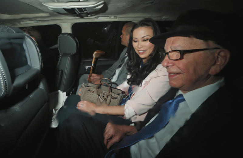 News Corp. chairman Rupert Murdoch, right, his wife Wendi Deng, center, and son Lachlan Murdoch sit in the back of a car as they are driven to the Leveson inquiry at the High Court in London, Thursday, April 26, 2012.  (AP Photo/Matt Dunham)