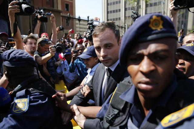 South African Olympic and Paralympic track star Oscar Pistorius leaves the North Gauteng High Court in Pretoria September 12, 2014. Pistorius was convicted of culpable homicide on Friday, escaping the more serious charge of murder for the killing of his girlfriend Reeva Steenkamp, and will now battle to avoid going to prison. REUTERS/Siphiwe Sibeko (SOUTH AFRICA - Tags: SPORT CRIME LAW ATHLETICS)
