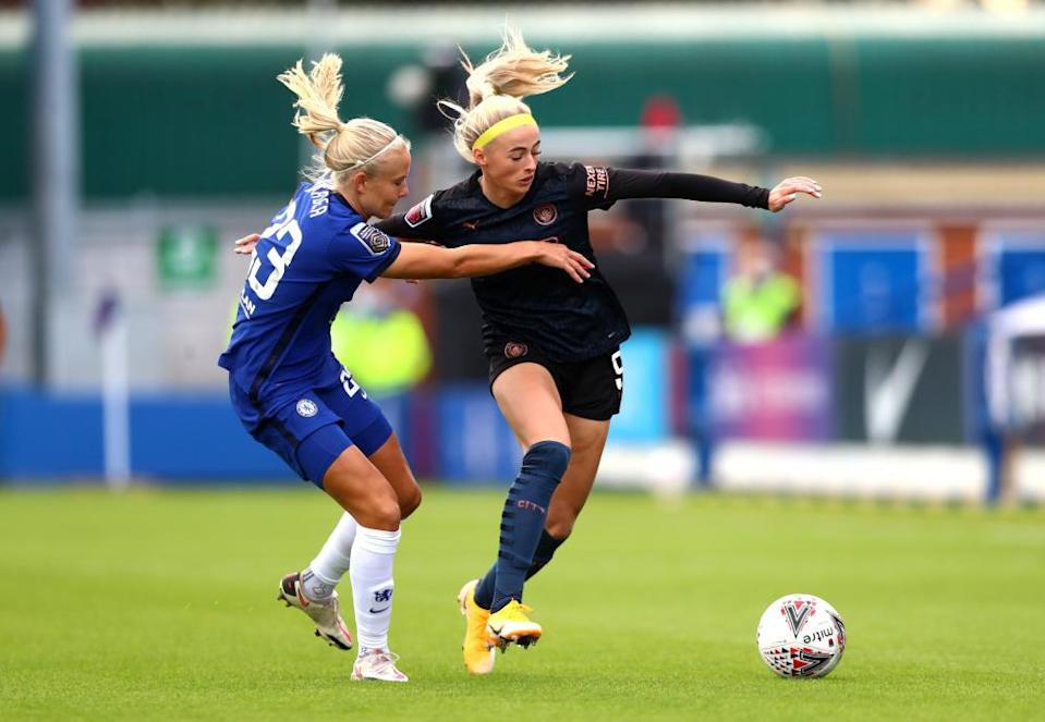 Chloe Kelly of Manchester City shrugs off the challenge of Chelsea's Pernille Harder