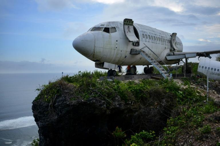 A retired Boeing aircraft has been hauled atop a seaside cliff near Bali's Nyang Nyang beach (AFP/SONNY TUMBELAKA)