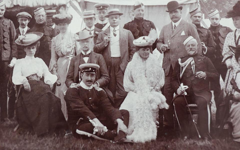 Eva (centre) with Frank Dugdale (seated with military cap) - TMG John Lawrence