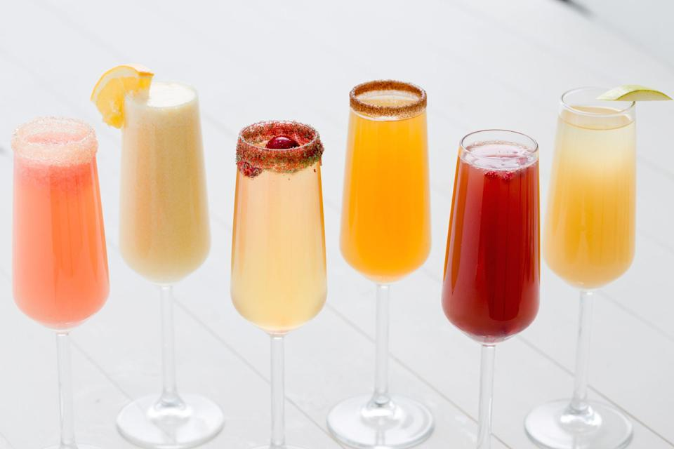 """<p>Sip to the season with these tasty—and super festive—mimosas. They're delicious any time of day!</p><p>Want even more mimosa ideas? Make sure to head <a href=""""https://www.delish.com/cooking/recipe-ideas/g2720/mimosa-recipes/"""" rel=""""nofollow noopener"""" target=""""_blank"""" data-ylk=""""slk:here"""" class=""""link rapid-noclick-resp"""">here</a>.</p>"""