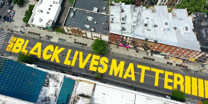 Black Lives Matter murals have been painted by activists in several US cities in recent days.