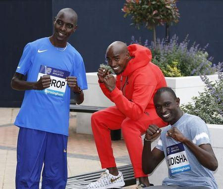 (From L-R) Kenya's Asbel Kiprop, Great Britain's Mo Farah and Kenya's David Rudisha pose ahead of the Birmingham Diamond League. Birmingham Diamond League Preview Press Conference - Crowne Plaza Hotel, Birmingham - 4/6/16. Reuters / Paul Childs