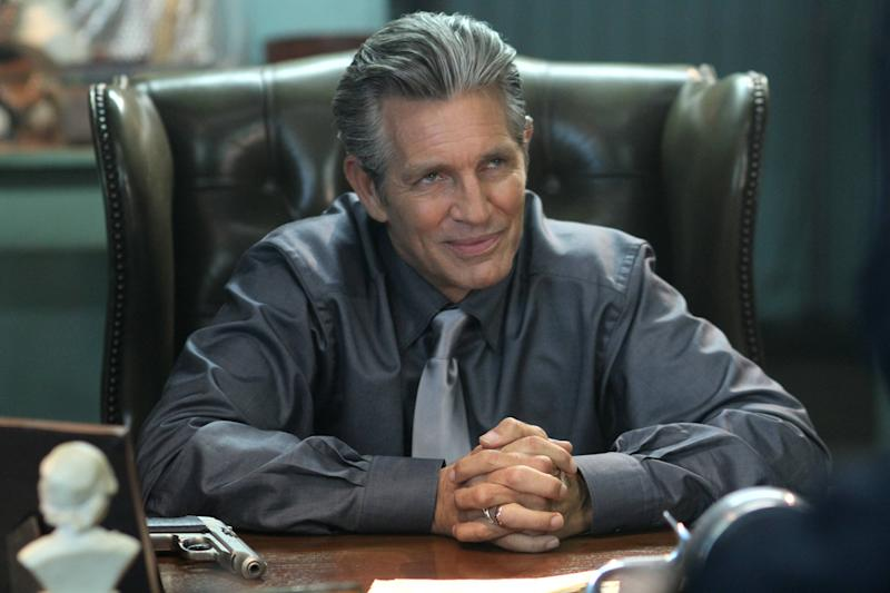 """This undated publicity photo released by Muse/IFC shows Eric Roberts, as crime lord Mr. Racken, in a scene from IFC's new action comedy """"Bullet In The Face."""" The series mixes darkly madcap humor, a silly but sadistic antihero and lots of violence in a stew that even Spencer is hard-pressed to define. (AP Photo/Muse/IFC, Philippe Bosse)"""