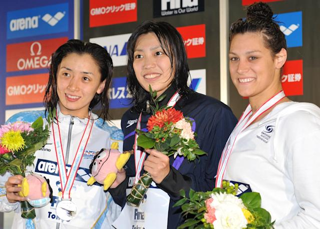 Winner Haruka Ueda of Japan (C), second place Hanae Ito of Japan (L) and thrid place Blair Evans of Australia (R) celebrate during the award ceremony of the women's 200m freestyle final at the FINA Swimming World Cup short-course meet in Tokyo on November 12, 2011. Ueda won the final with a time of 1:53.77seconds. AFP PHOTO/KAZUHIRO NOGI (Photo credit should read KAZUHIRO NOGI/AFP/Getty Images)