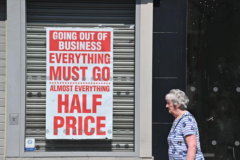 "A pedestrian walks past a shuttered jewellery store with a closing down sale poster in the window in Chester, northwest England on August 12, 2020. - Britain's economy contracted by a record 20.4 percent in the second quarter with the country in lockdown over the novel coronavirus pandemic, official data showed Wednesday. ""It is clear that the UK is in the largest recession on record,"" the Office for National Statistics said. Britain officially entered recession in the second quarter after gross domestic product (GDP) contracted by 2.2 percent in the first three months of the year. (Photo by Paul ELLIS / AFP) (Photo by PAUL ELLIS/AFP via Getty Images)"