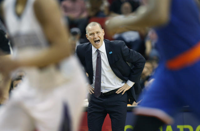 Sacramento Kings head Coach Michael Malone directs his players against the New York Knicks during the second half of an NBA basketball game in Sacramento, Calif., on Wednesday, March 26, 2014.The Knicks won 107-99.(AP Photo/Steve Yeater)